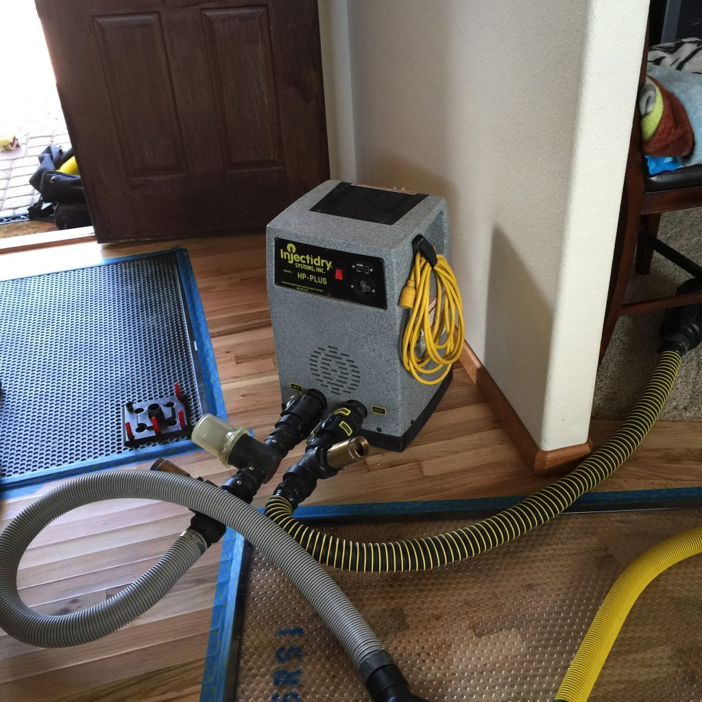 Injectidry system drying a hardwood floor